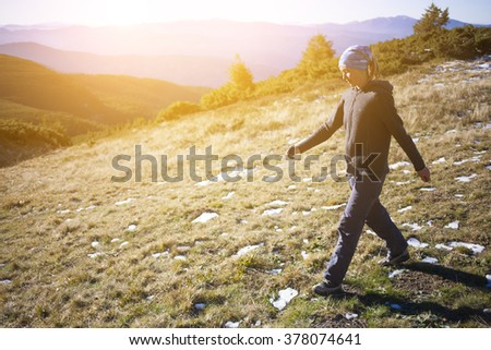 A young girl takes a walk in the fresh air.