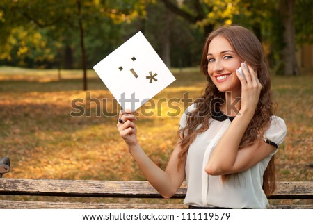 A young girl talks by cell phone - stock photo