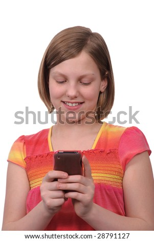A young girl texting messages on a smart phone - stock photo