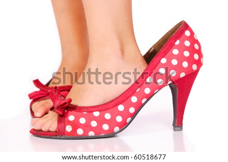 A Young Girl Walking In Mummy 's Shoes - stock photo