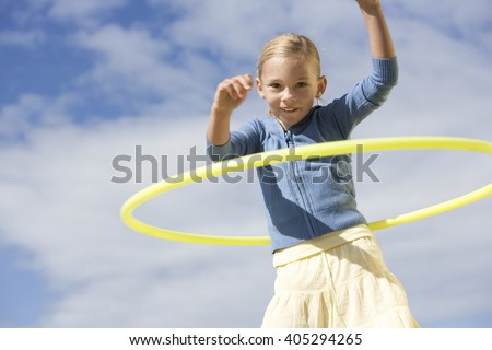 A young girl with a hoop - stock photo