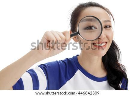 A young girl with a magnifying glass