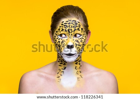 a young girl with a wild and creative leopard make up - stock photo