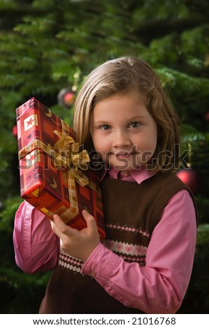 a young girl with christmas present - stock photo