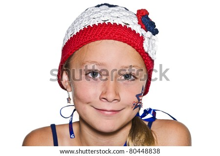 A young girl with crocheted hat in red, white, and blue.