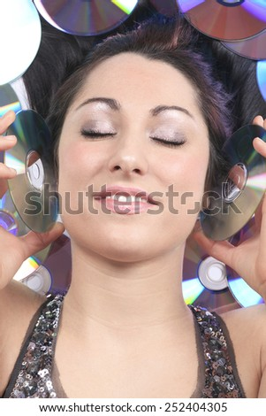 A young girl with DVDs record lay on the ground - stock photo