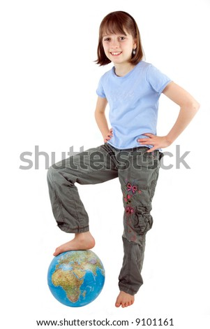 A young girl with foot on the globe against white background