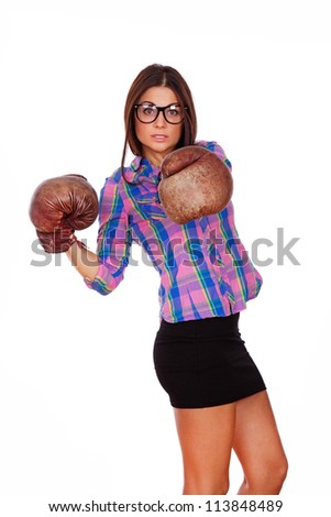 A young girl with glasses is boxing
