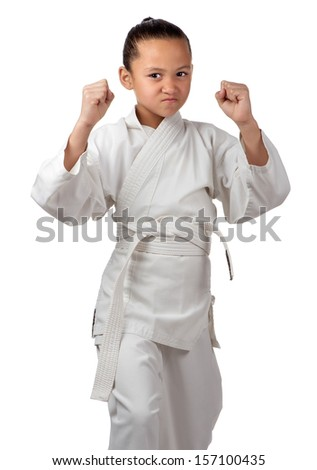 A young girl with white karate belt is ready to start her training. - stock photo