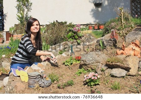 a young girl working in the garden - stock photo