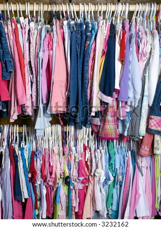 A Young Girls Closet Is Stuffed Full Of Colorful Summer Wear