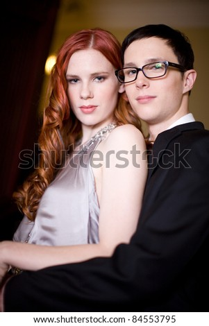 A young glamorous looking couple in formal wear - stock photo