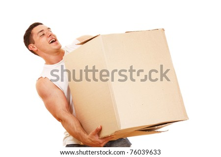 A young guy carrying a box - stock photo