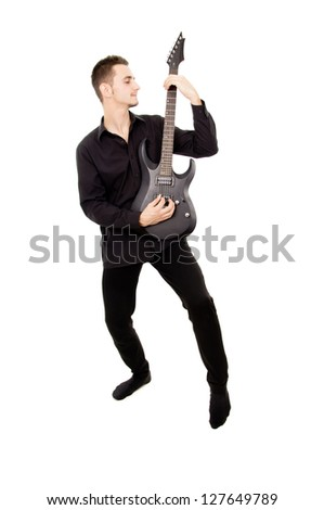 a young guy in black clothes plays the guitar isolated on white background