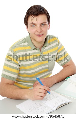 A young guy studying, isolated on white, from above