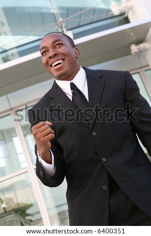 A young, handsome business man celebrating a success