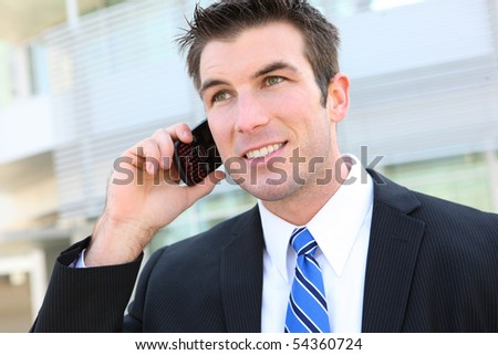 A young handsome business man walking outside office building - stock photo