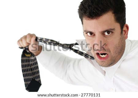 A young handsome businessman ripping off his tie over white - stock photo