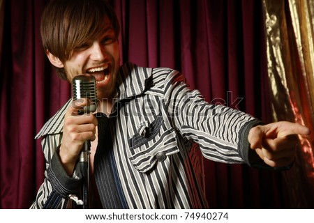 A young handsome singer - stock photo