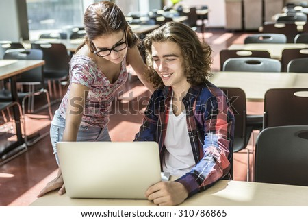 A Young handsome woman and men student at the college - stock photo