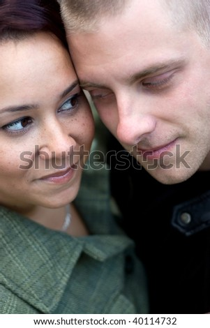 A young happy couple gazing into each others eyes. - stock photo