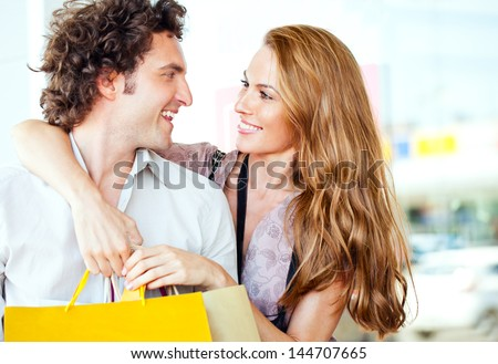 A young happy couple shopping together. - stock photo
