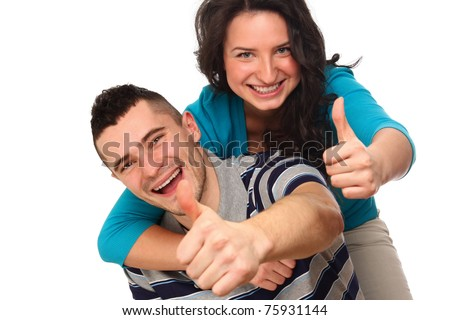 A young happy couple showing ok - stock photo