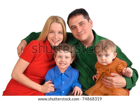 A young happy family is smiling in a portrait with bright colors on a white background. - stock photo