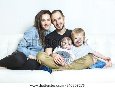 A Young happy family with two children at home