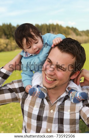 A young happy father 25 years with his 4  month old son - stock photo