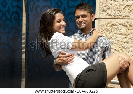 A young happy Indian couple. - stock photo