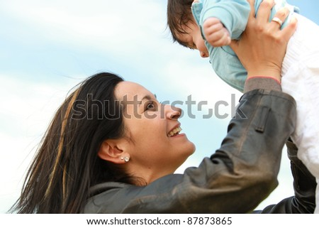 A young happy mother 22 years with her 4  month old son....