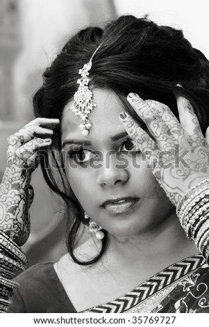 A young hindu woman prepares for her wedding day - stock photo