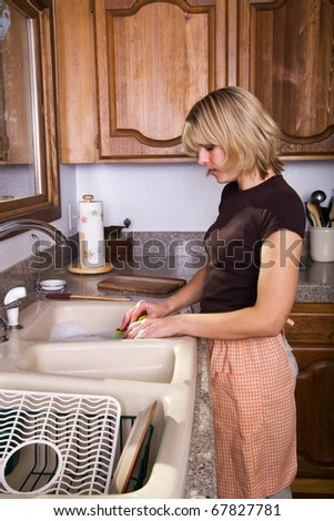 a young housewife doing dishes