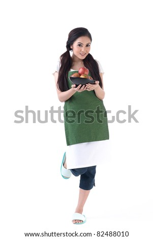 A young housewife holding a bowl of apples - stock photo
