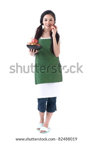 A young housewife holding a bowl of apples and other hand holding an apple - stock photo