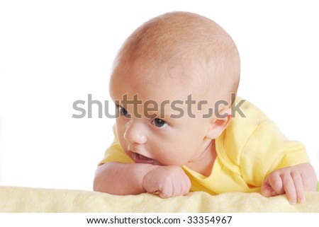 A young infant beginning to pick his head up on his own.  Isolated on white. - stock photo