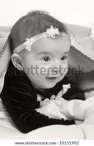A young infant girl. Childhood, babies, family - stock photo