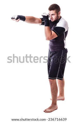 a young kickboxer or boxer isolated over a white background