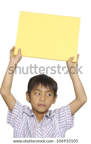 a young kid holding a empty placard on his head - stock photo