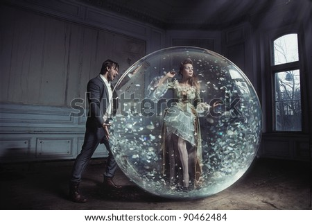 A young lady got stuck in crystal ball - stock photo