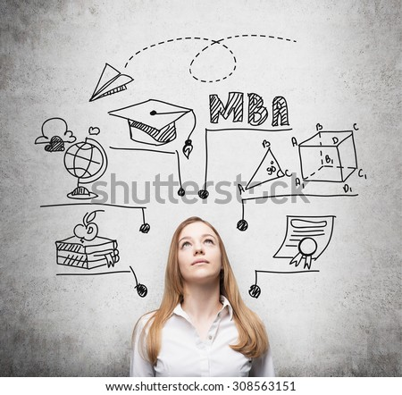 A young lady is thinking about MBA degree. Educational chart is drawn behind her. A concept of further business education. Concrete background. - stock photo