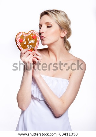 a young lady with a gingerbread heart