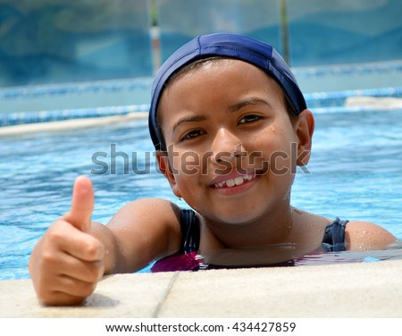 A young latinamerican girl in the swimming pool.