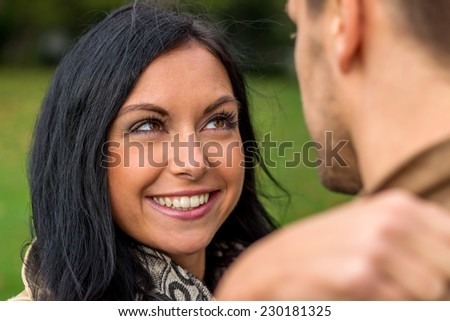 a young, laughed liebtes couple in a park - stock photo