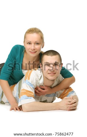 A young loving couple lying on the floor