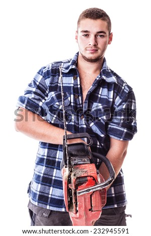 a young lumberjack wearing a checkered shirt and holding a chainsaw isolated over white background - stock photo