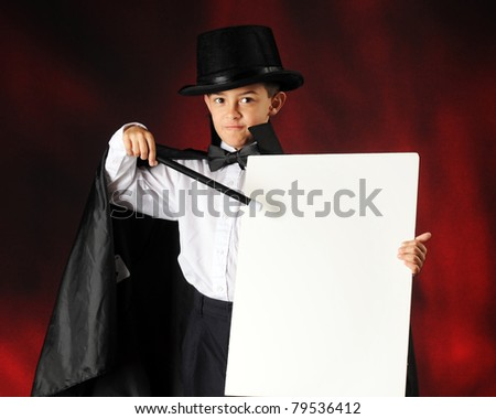 A young magician pointing to a blank sign (for your text) with his wand.