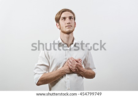 A Young Male Adult in White Shirt Listening National Anthem. Patriot. - stock photo