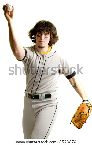 A young male baseball player pitching. - stock photo